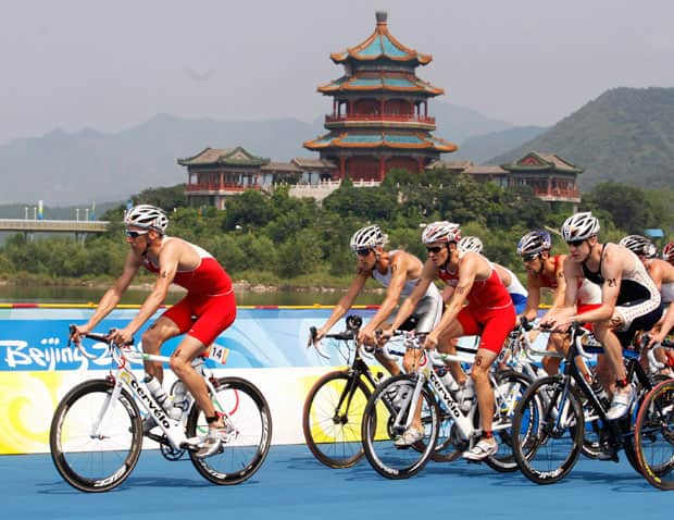 Canada's Colin Jenkins, left, leads Simon Whitfield in the cycling portion of the men's triathlon at the 2008 Summer Olympics in Beijing. Whitfield finished in second place to take the silver medal. THE CANADIAN PRESS/Ryan Remiorz