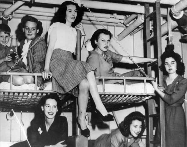 September 10, 1945 - Canadian war brides on board the aircraft carrier Reaper as it enters the Syndney Harbour.