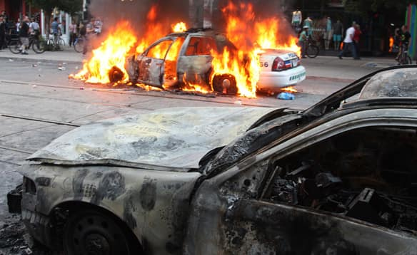 phpUMxrRPburning-police-vehicle-2.jpg