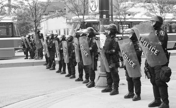 riotpolicecarmen.jpg