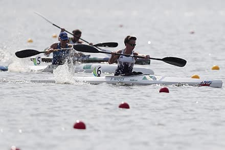three athletes in their boats take off at the beginning of the race