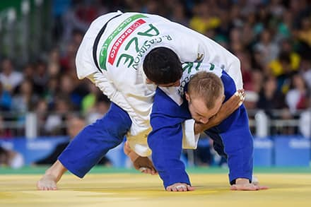 an athlete tries to pin another to the mat