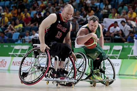 an athlete bumps his wheelchair into his opponent to try and block him