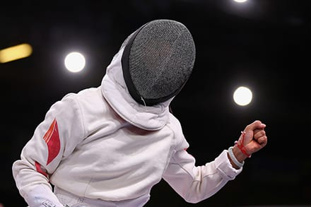 Close-up of fencing outfit showing the metal mesh headgear