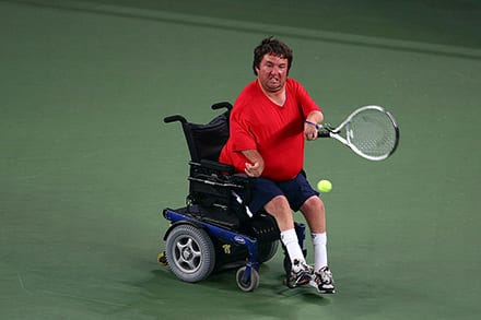an athlete has a strap on their wrist that helps them hold the tennis racket