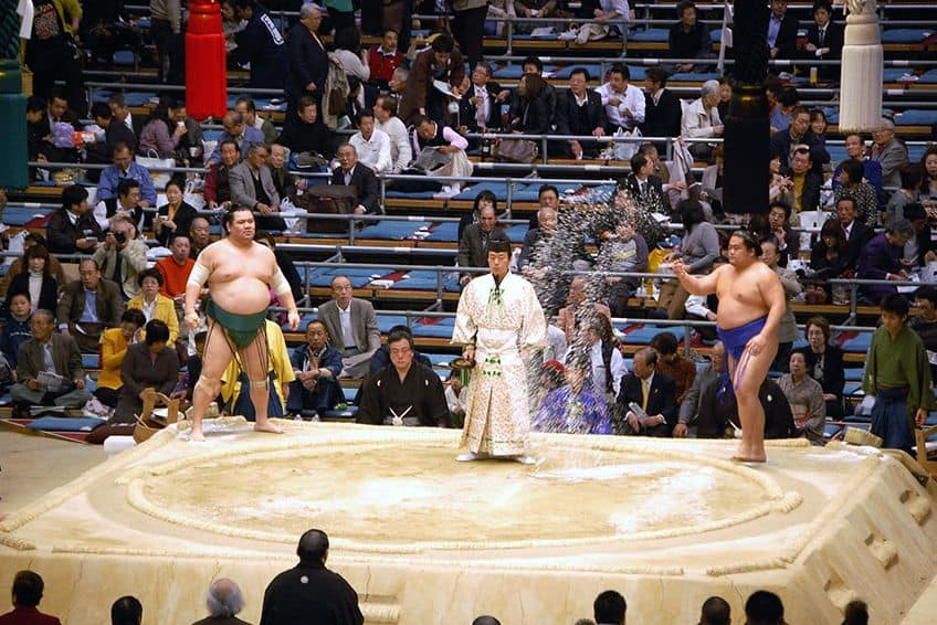 Sumo wrestlers in the ring.
