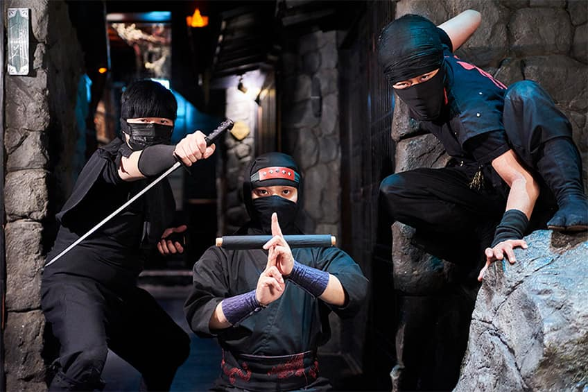three people dressed up as ninjas at the Ninja Restaurant