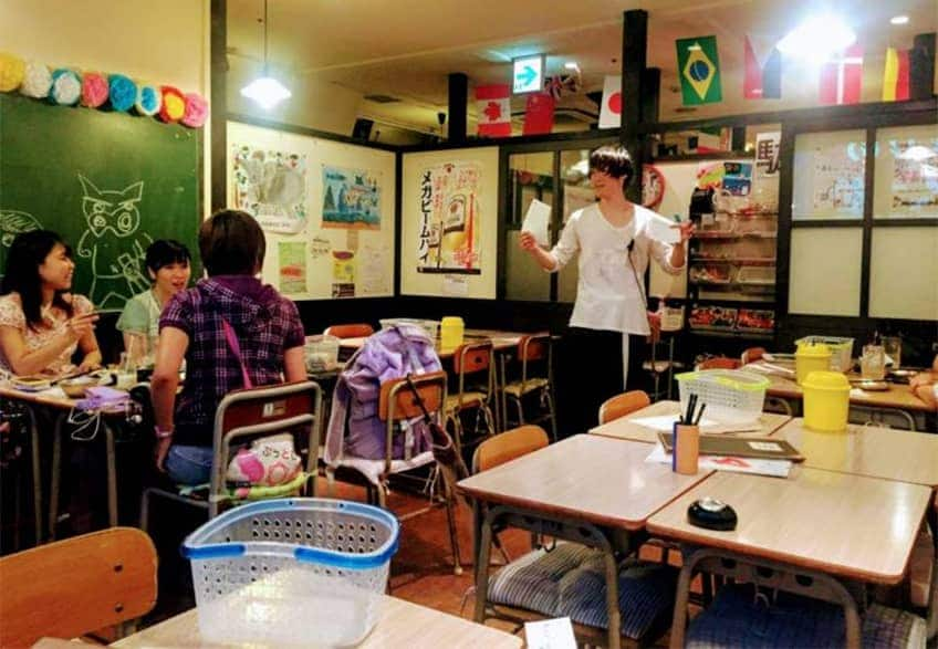 a family eats at a restaurant that looks like a schoolroom