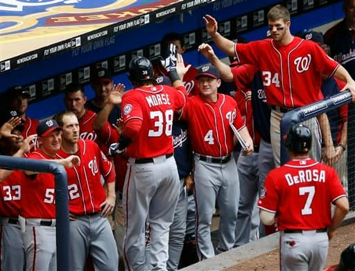 Washington Nationals' Michael Morse is greeted by his teammates after he hit a two-run home run off of Milwaukee Brewers' John Axford in the ninth inning of a baseball game, Sunday, July 29, 2012, in Milwaukee. (AP Photo/Tom Lynn)}