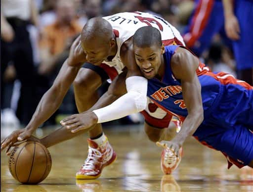 Detroit Pistons guard Kim English, right, and Miami Heat guard Ray Allen dive for a loose ball during the second half of an NBA basketball game, Friday, Jan. 25, 2013, in Miami. The Heat defeated the Pistons 110-88. (AP Photo/Wilfredo Lee)