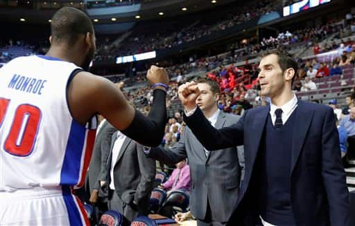 Detroit Pistons guard Jose Calderon, right, gets a fist bump from center Greg Monroe (10) before the Pistons' NBA basketball game against the Cleveland Cavaliers on Friday, Feb. 1, 2013, in Auburn Hills, Mich. Calderon was acquired in a trade from the Toronto Raptors but did not play Friday. (AP Photo/Duane Burleson)