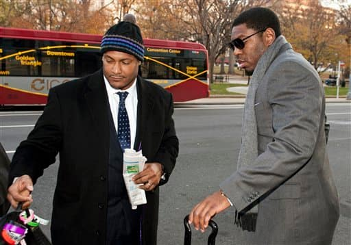 FILE - In this Nov. 30, 2012, file photo, New Orleans Saints football defensive end Will Smith, left, and linebacker Jonathan Vilma arrive at an attorney's office in Washington, for a hearing on their appeals of bounties suspensions. Former Commissioner Paul Tagliabue, who was appointed to handle a second round of player appeals to the league, has informed all parties he planned to rule by Tuesday, Dec. 11, and his decision could affect whether two current Saints  Jonathan Vilma and Will Smith  get to play out the season. (AP Photo/Cliff Owen, File)