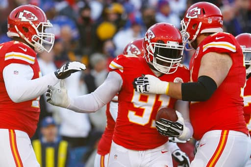 Kansas City Chiefs outside linebacker Tamba Hali (91) celebrates with teammates after returning a recovered fumble into the end zone for a touchdown past Buffalo Bills quarterback Jeff Tuel (7) during the second half of an NFL football game in Orchard Park, N.Y., Sunday, Nov. 3, 2013. (AP Photo/ Bill Wippert)