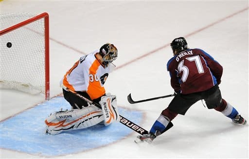 Colorado Avalanche center Ryan O'Reilly, right, scores the game-winning goal against Philadelphia Flyers goalie Ilya Bryzgalov, of Russia, in an overtime shootout in an NHL hockey game on Monday, Dec. 19, 2011, in Denver. The Avalanche won 3-2 in an overtime shootout. (AP Photo/Chris Schneider)