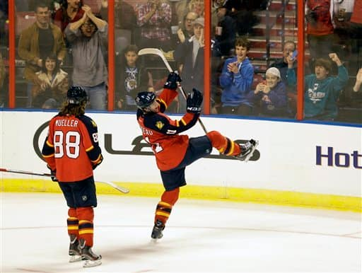 Florida Panthers center Jonathan Huberdeau, front right, of Canada, celebrates his first goal as right wing Peter Mueller (88) looks on during the first period of an NHL hockey game against the Carolina Hurricanes, Saturday, Jan. 19, 2013, in Sunrise, Fla. (AP Photo/Wilfredo Lee)