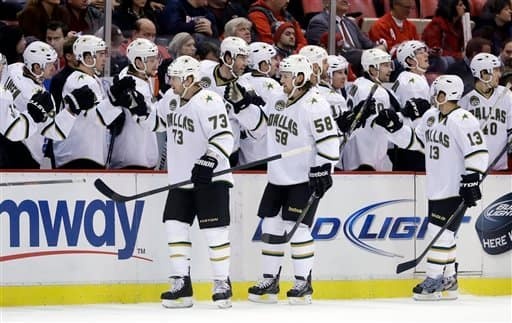 Dallas Stars right wing Michael Ryder (73) is congratulated by teammates after his goal during the first period of an NHL hockey game against the Detroit Red Wings in Detroit, Tuesday, Jan. 22, 2013. (AP Photo/Carlos Osorio)