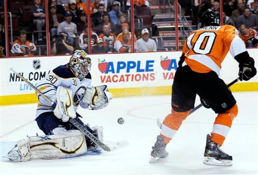 Buffalo Sabres' Ryan Miller (30) makes a save on a shot by Philadelphia Flyers' Brayden Schenn in the second period of an NHL hockey game, Sunday, March 10, 2013, in Philadelphia. (AP Photo/Michael Perez)
