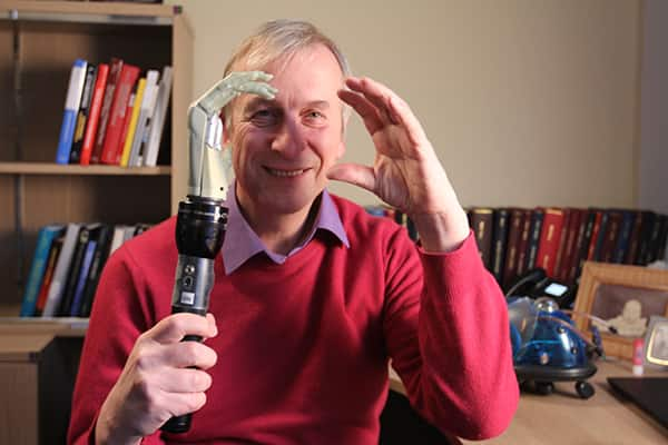 Cybernetics professor Kevin Warwick holds artificial hand