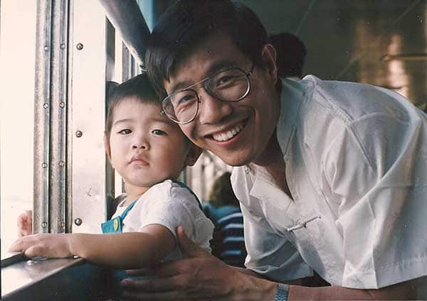 Father with son at window