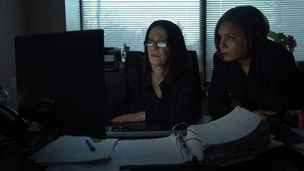 two women behind computer