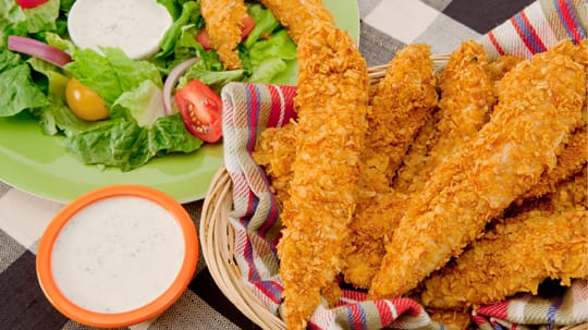 These baked-not-fried chicken fingers have a healthy crunch. Serve ...