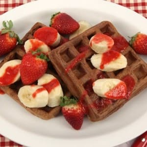 Double Chocolate Chip Waffles with Bananas and Strawberry Coulis