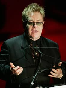 Elton John is critical both of organized religion and politically passive musicians.