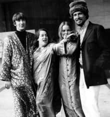 The pop group the Mamas and the Papas pose outside a hotel in London, England, in this Oct. 6, 1967, photo. The four members are, left to right, Denny Doherty, Cassandra Elliot, Michelle Phillips, and John Phillips.