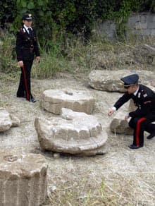 Carabinieri police officers inspect the ruins of an ancient Greek temple in Torre Melissa, Italy, where a developer was about to build.