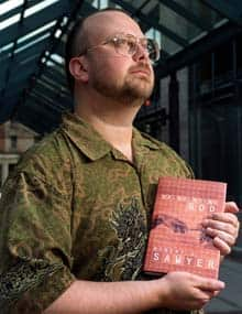 Science fiction author Robert Sawyer holds his book Calculating God in 2000. His next book will feature themes about China.