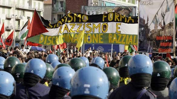 Italian police officers wearing blue helmets look on during a demonstration described by organizers as pro-Palestinian, outside the Lingotto building, venue of the Turin book fair, in Turin, northern Italy on Saturday.