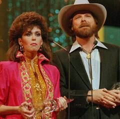 Dan Seals, right, and Marie Osmond, shown on Oct. 14 1986, accept the vocal duo of the year award during the Country Music Association awards show in Nashville, Tenn.