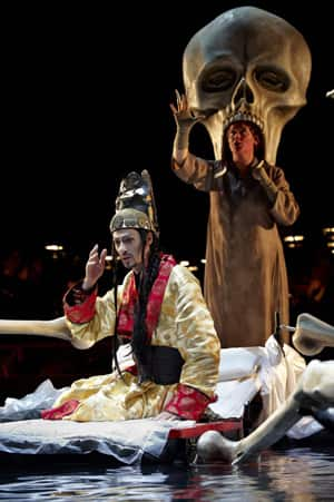Ilya Bannik, front, as the Emperor and Maria Radner as Death in the Canadian Opera Company production of The Nightingale and Other Short Fables. The opera heads to the U.S. next March.