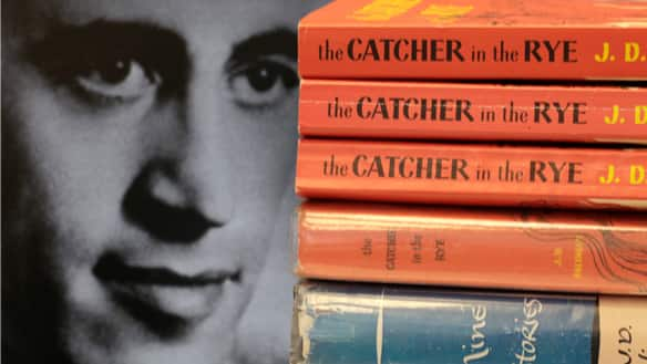J.D. Salinger and his two best-known books: the classic novel The Catcher in the Rye and his short story collection Nine Stories.
