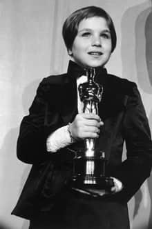 Tatum O'Neal holds her Oscar for Best Supporting Actress, which  she won for her role in Paper Moon, at the 1974 Academy Awards.