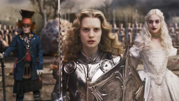 Alice (Mia Wasikowska) joins the Mad Hatter (Johnny Depp) and the White Queen (Anne Hathaway) in director Tim Burton's Alice in Wonderland.