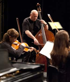 Composer Gavin Bryars, back, performs with members of Aventa at the Banff Centre for the Arts.