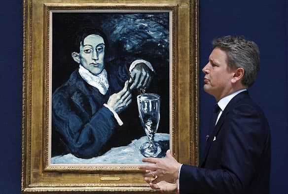 Jussi Pylkkanen, president of Christie's Europe, discusses Pablo Picasso's 1903 painting Portrait of Angel Fernandez de Soto in London in June. The painting fetched $54 million at auction on Wednesday.