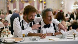 Paul Giamatti, left, and Dustin Hoffman in a scene from Barney's Version. Screenwriter Michael Konyves and director Richard J. Lewis accepted Telefilm Canada's Golden Box Office Award for the film on Thursday.