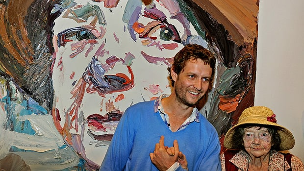 Artist Ben Quilty stands in front of his Archibald Prize-winning portrait with its subject, legendary Australian painter Margaret Olley.