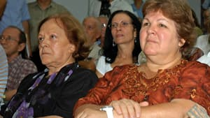 Ernesto Che Guevara's widow, Aleida March (left) and one of his daughters, Aleida Guevara (right), attend the launch of Diary of a Combatant in Havana on Tuesday.