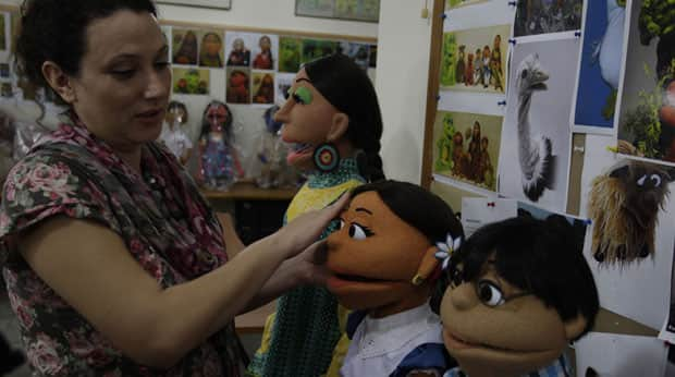A Pakistani artist gives final touches to characters of Pakistani version of Sesame Street in Lahore on Oct. 13. The show Sim Sim Hamara debuted this past weekend.