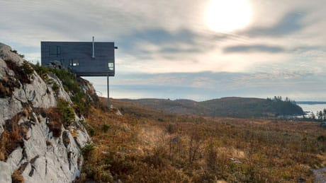MacKay-Lyons Sweetapple Architects of Halifax designed the rustic retreat atop a stone cliff looking out over the sea.