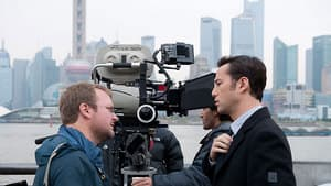 Writer-director Rian Johnson, left, and actor Joseph Gordon-Levitt are seen filming on Shanghai's famed waterfront for the U.S.-China co-production Looper, which opened TIFF 2012.