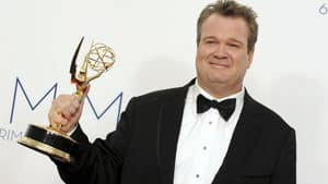 Eric Stonestreet poses backstage with his award for best supporting actor in a comedy series for Modern Family.
