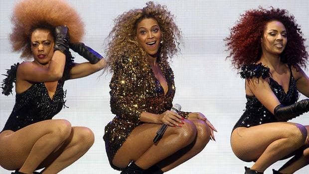Beyonce Knowles, seen at centre performing at the 2011 Glastonbury Festival, has nabbed the high-profile Super Bowl halftime show, according to an AP source.