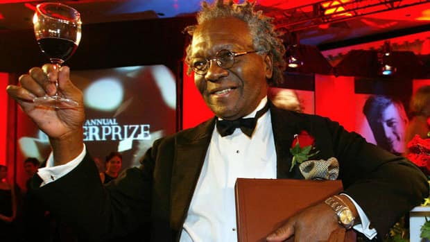 Austin Clarke celebrates after winning the Giller Prize for the Polished Hoe in 2002. He has been named winner of the Harbourfront Festival Prize.