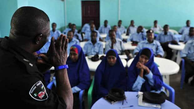 Police personnel undergo criminal investigation training at the General Kaahiye Police Academy in Mogadishu on Oct. 21. Somali poet and writer Warsame Shire Awale urged young people to join the police.