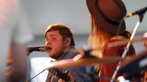 Raggi Thorhallsson of Icelandic band Of Monsters and Men performs at the Newport Folk Festival on July 29.