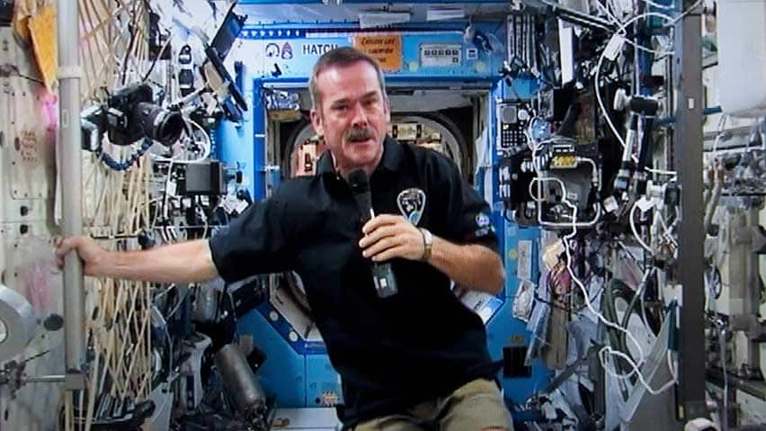 Canadian astronaut Chris Hadfield responds to a question during a news conference from the International Space Station on a photograph taken from a television monitor Thursday, January 10, 2013 in St-Hubert, Que. THE CANADIAN PRESS/Paul Chiasson